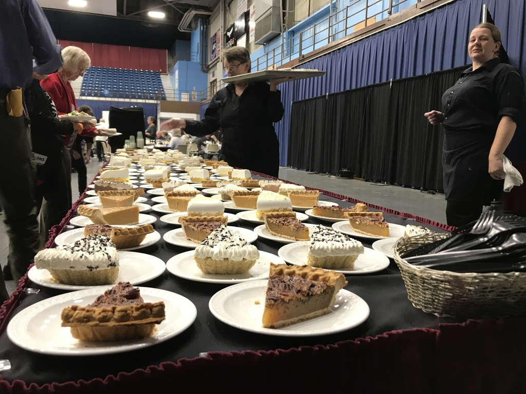 Dessert table with slices of pie.